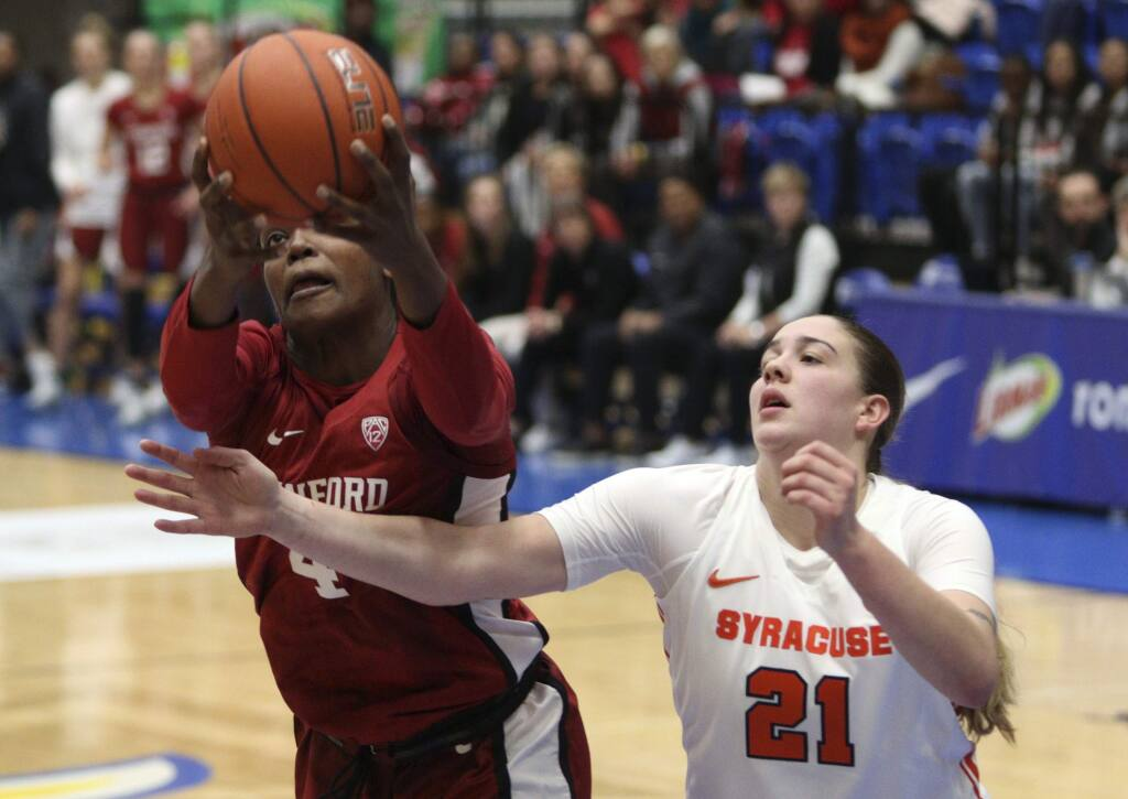 Stanford's Nadia Fingall holds on to the ball as Syracuse's Emily Engstler tries to steal it during the first half Friday, Nov. 29 2019, in Victoria, British Columbia. (Chad Hipolito/The Canadian Press via AP)