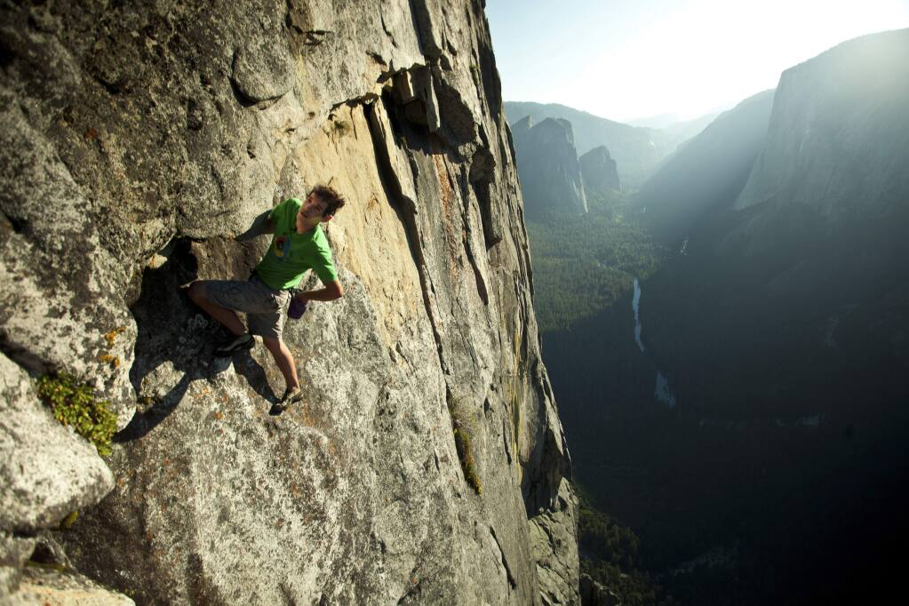 In a handout photo from 2011, Alex Honnold climbs without the aid of ropes in Yosemite. (Peter Mortimer via The New York Times)