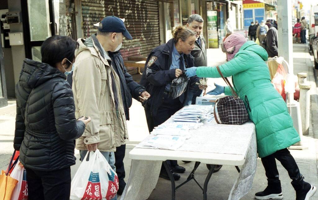 Police Buying Facemasks China Town NYJOSHUA TORRES