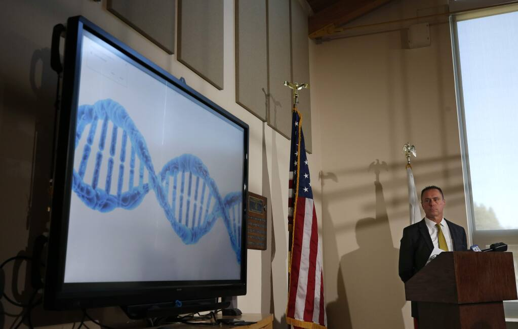 El Dorado County District Attorney Vern Pierson displays a generic genetic DNA ribbon as he discusses how new DNA evidence was used to help exonerate a man who spent about 15 years in prison after being wrongly convicted of killing his housemate, during a news conference in Placerville, Calif., Thursday, Feb. 13, 2020. Ricky Davis was convicted in 2004 of second degree murder in the stabbing death of a newspaper columnist. But the conviction was thrown out after new evidence was found implicating another person. (AP Photo/Rich Pedroncelli)