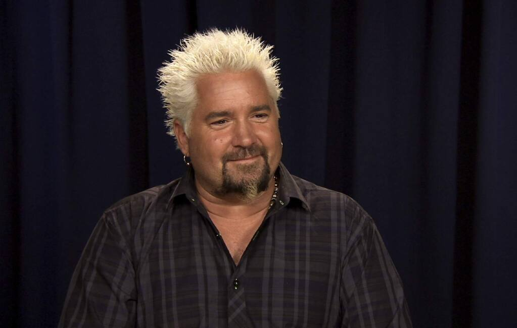 This Oct. 11, 2016 image taken from video shows celebrity chef Guy Fieri during an interview in New York. (Bruce Barton/AP)