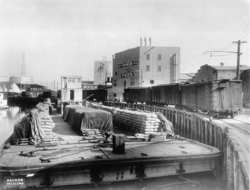 At one point, the Petaluma River was the third-largest transportation waterway in California. This undated photo shows a barge docked at what is now Water Street. SONOMA COUNTY LIBRARY