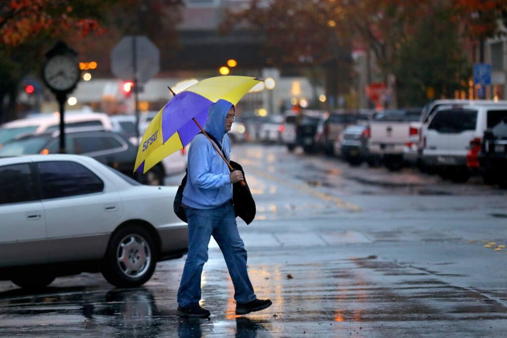 Traian Muntean walks through Railroad Square in Santa Rosa on Sunday, Dec. 1, 2019. (BETH SCHLANKER/ PD)