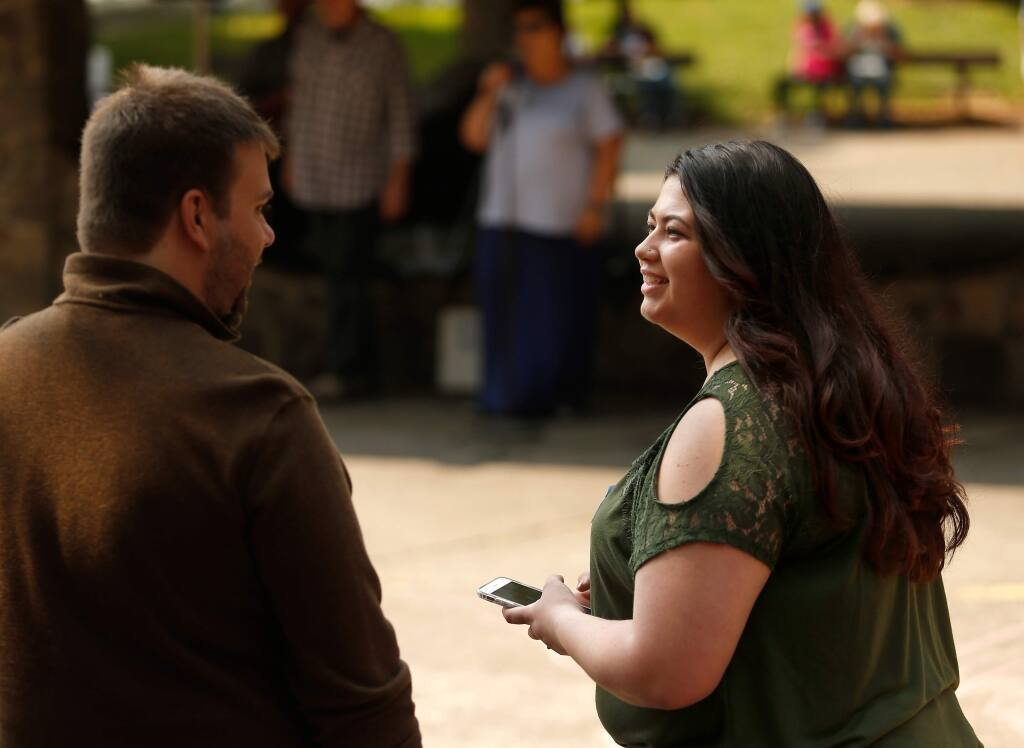 Santa Rosa school board candidate Lyndsey Burcina talks Ian Maurer of Santa Rosa during a Sonoma County Democratic Party barebecue at Howarth Park in Santa Rosa, California, on Saturday, August 25, 2018. (Alvin Jornada / The Press Democrat)