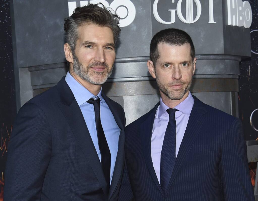 "FILE - In this Wednesday, April 3, 2019, file photo, creator/executive producers David Benioff, left, and D. B. Weiss attend HBO's 'Game of Thrones' final season premiere at Radio City Music Hall in New York. Walt Disney Co. CEO Bob Iger said Tuesday, May 14, 2019, that ""Game of Thrones"" showrunners Benioff and Weiss are working on the new ""Star Wars"" film expected in theaters in December 2022. (Photo by Evan Agostini/Invision/AP, File)"