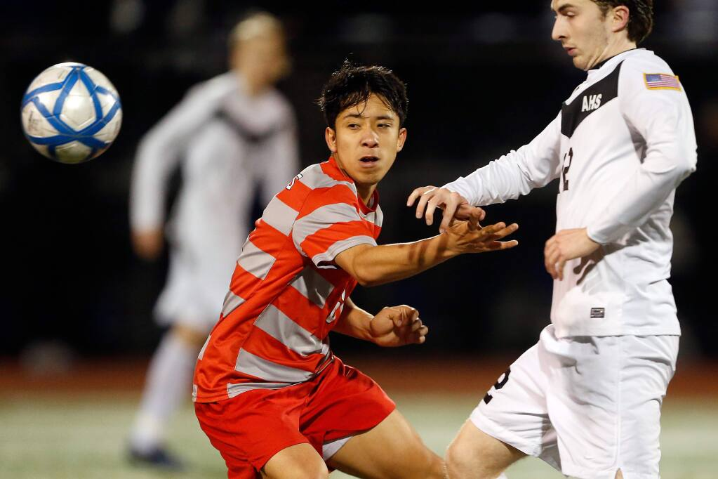Montgomery's Bryan Rosales (6), left, works to get the ball back from Acalanes' Bryan Bamford (12) during overtime in the NCS Division 2 boys varsity soccer championship match between Montgomery and Acalanes high schools in Lafayette, California on Saturday, February 25, 2017. (Alvin Jornada / The Press Democrat)