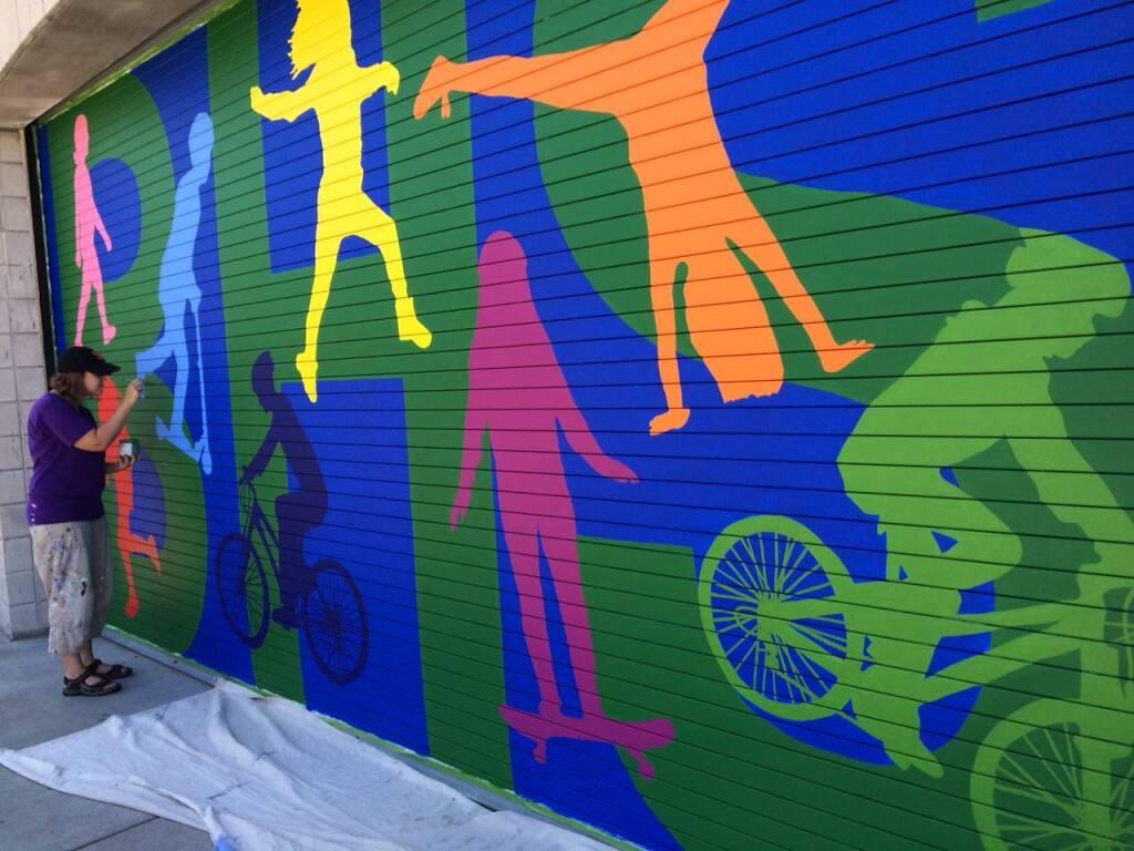 PHOTO: 1 by Dana VallarinoSebastopol artist Dana Vallarino paints a mural at Brook Haven School in Sebastopol.