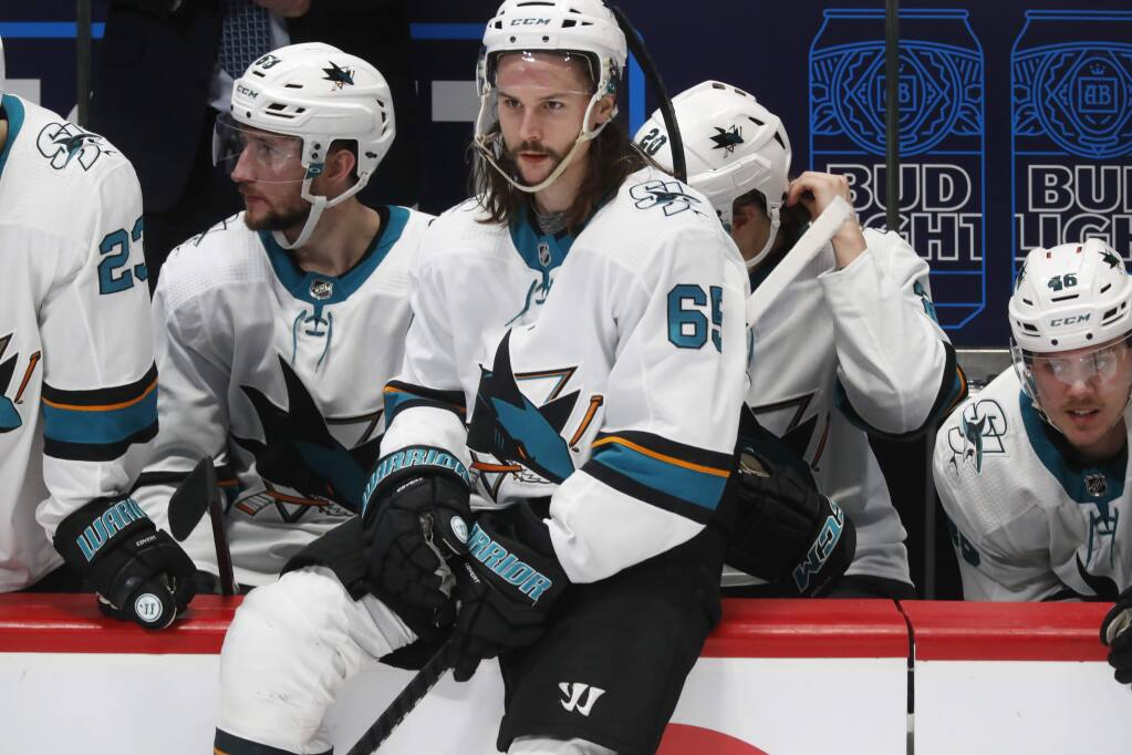 San Jose Sharks defenseman Erik Karlsson sits on the rail of the team box during a stop in play late in the third period against the Colorado Avalanche on Thursday, Jan. 16, 2020, in Denver. Colorado won 4-0. (AP Photo/David Zalubowski)