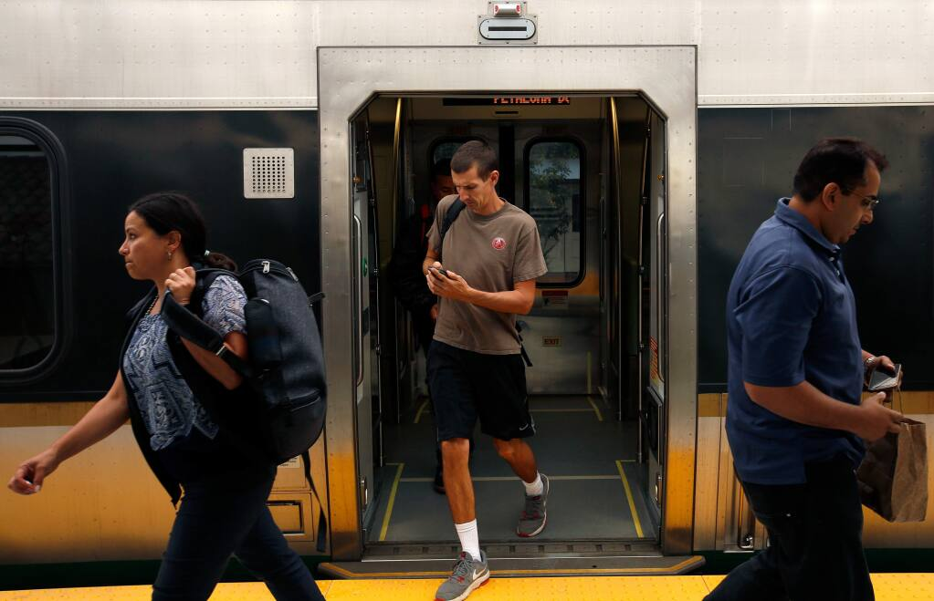 Commuters disembark the SMART train in Petaluma, California, on Wednesday, September 20, 2017. (Alvin Jornada / The Press Democrat)