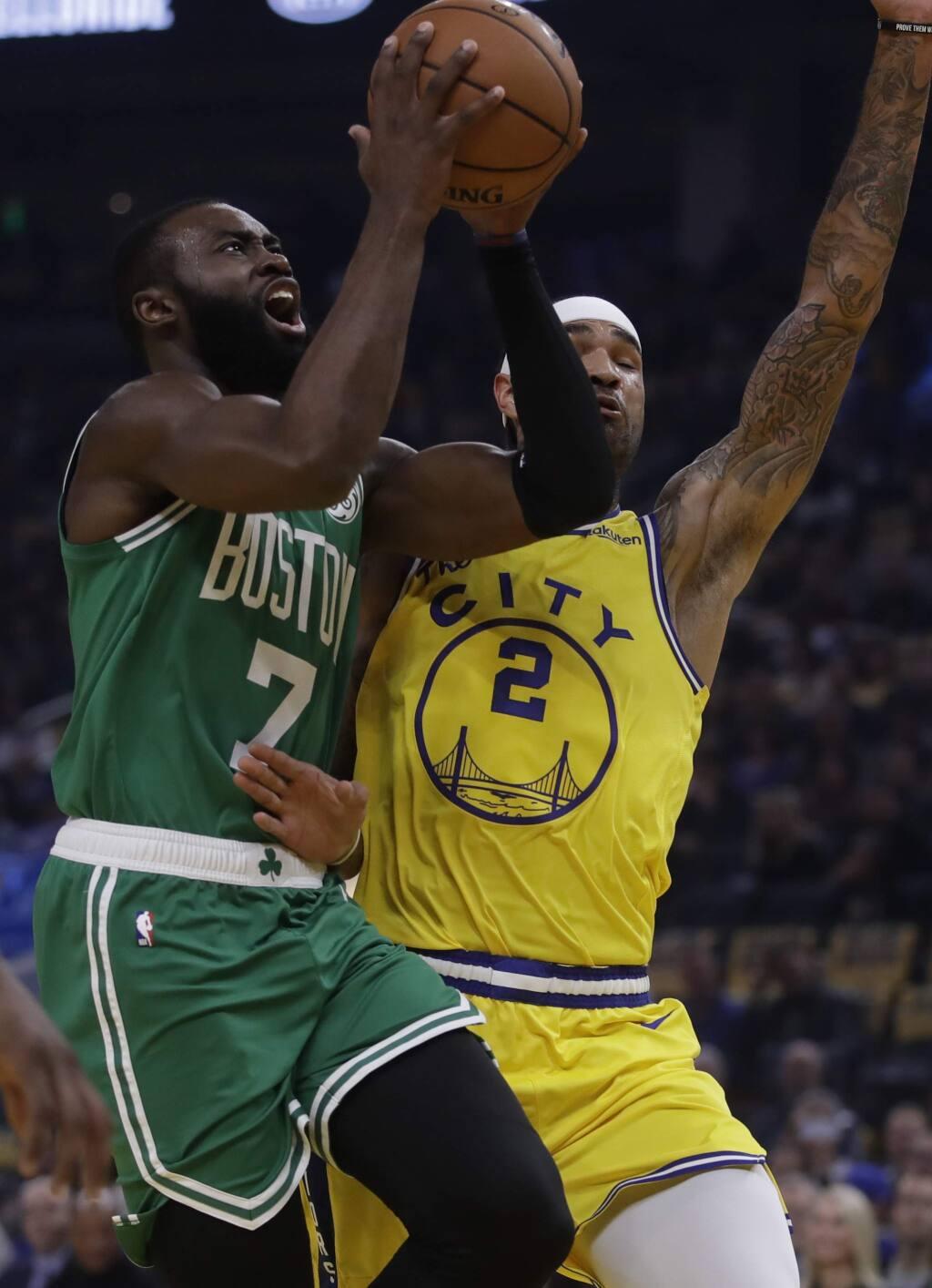 Boston Celtics' Jaylen Brown, left, shoots against Golden State Warriors' Willie Cauley-Stein (2) in the first half of an NBA basketball game Friday, Nov. 15, 2019, in San Francisco. (AP Photo/Ben Margot)