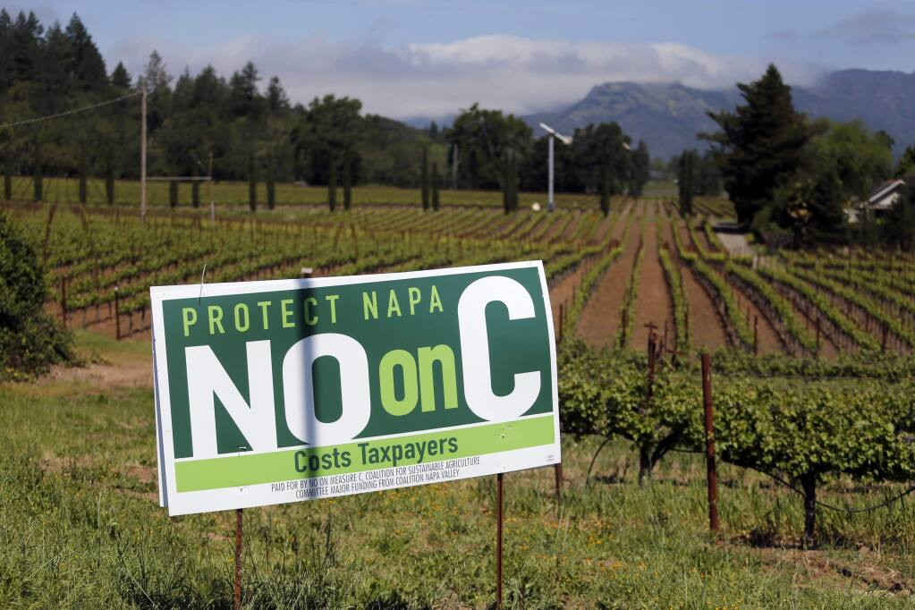 A sign opposes Measure C in Napa County. Photo taken on Thursday, May 3, 2018 in St. Helena, California . (BETH SCHLANKER/The Press Democrat)