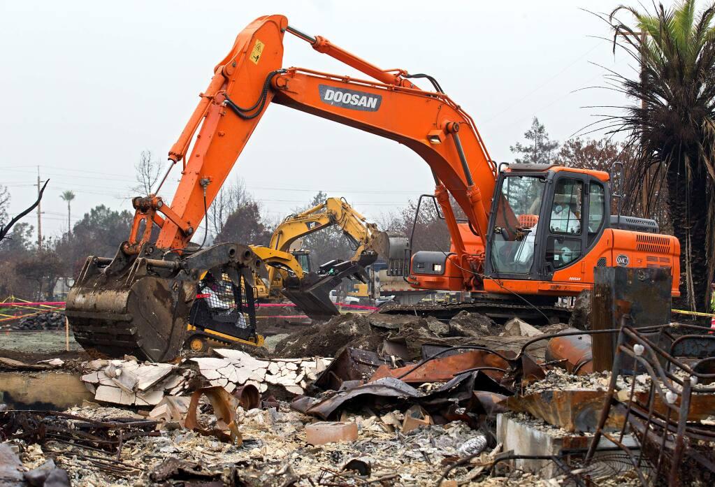 Debris removal crews clear lots in the Coffey Park area of Santa Rosa on Thursday, Jan. 4, 2018. (JOHN BURGESS/ PD)