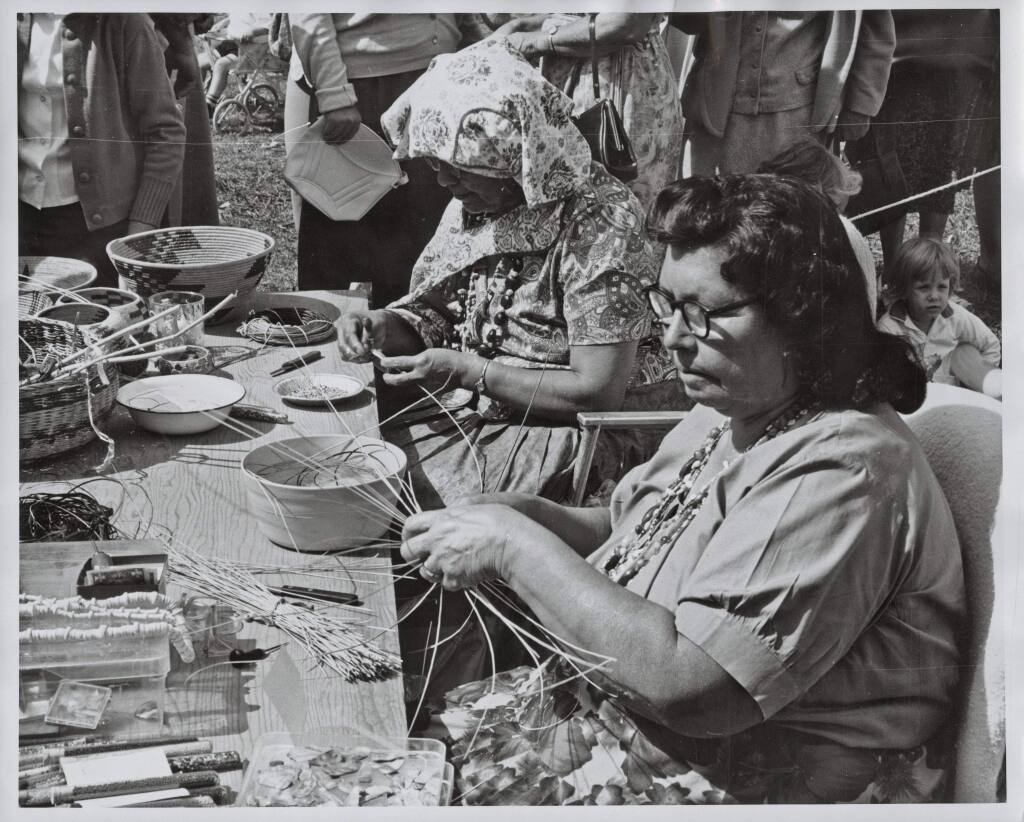 Essie Parrish (1902-1979), pictured here wearing glasses, was a Pomo basket weaver and spiritual leader who preserved the language and culture of her people. In the 1920s she established a bilingual language and cultural class at Stewarts Point Rancheria. She also contributed to documentaries about Kashia Pomo culture and collaborated with UC Berkeley linguist Robert Oswalt on a dictionary of the Kashia Pomo language. (Sonoma County Library)
