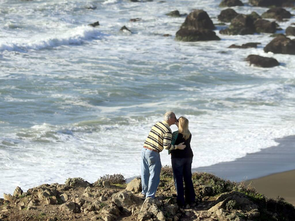 Sonny and Kayla McCauley of Albany, Texas smooch with a view of the Sonoma Coast, north of Bodega Bay in 2015. (KENT PORTER/ PD FILE)