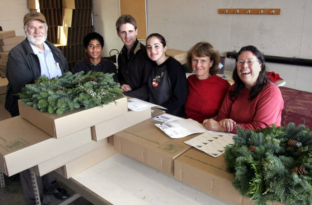 The Starcross family at the Rohnert Park warehouse for their Christmas wreath business. From left, Brother Toby McCarroll , Andrew, David, Holly, Sister Julie and Sister Marti. (PD FILE, 2005)