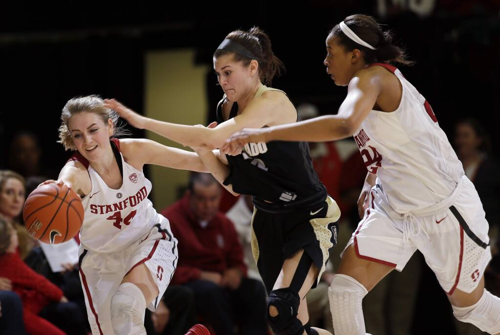 Stanford guard Karlie Samuelson, left, battles for a loose ball against Colorado's Lauren Huggins, center, during a game in January. (AP Photo/Marcio Jose Sanchez)