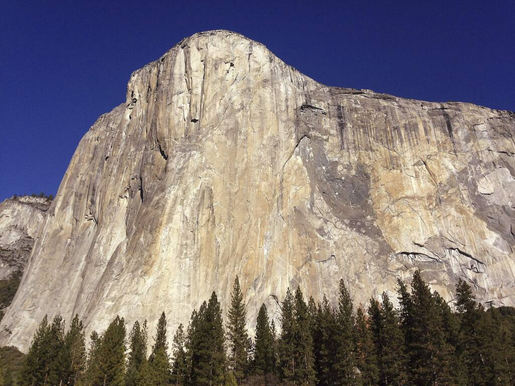 FILE - This Jan. 14, 2015, file photo, shows El Capitan in Yosemite National Park, Calif. Two climbers have set a new speed record for ascending the famous Nose route of El Capitan, one of the world's most technical and dangerous verticals. Alex Honnold and his climbing partner Tommy Caldwell on Wednesday, May 30, 2018, raced up the nearly 90-degree, 2,900-foot precipice in 2 hours 10 minutes 15 seconds. (AP Photo/Ben Margot, File)