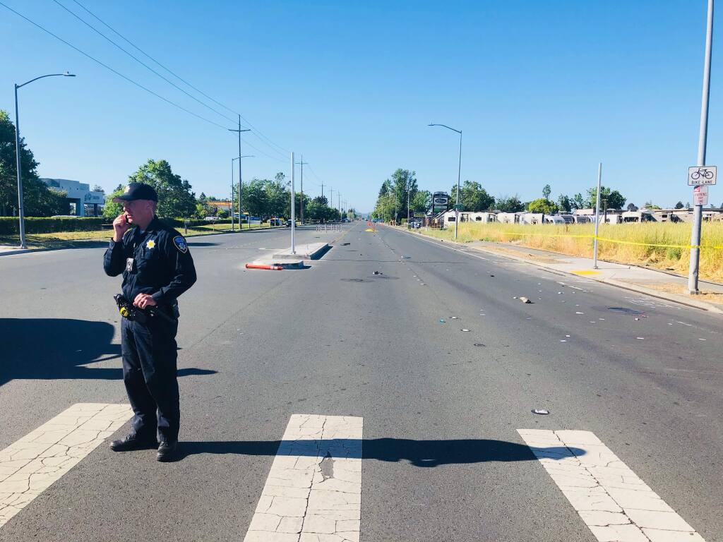 Santa Rosa police investigate a fatal alleged hit-and-run involving a suspected drunk driver and a pedestrian on Santa Rosa Avenue on Saturday, June 2, 2018. (JD Morris/The Press Democrat)