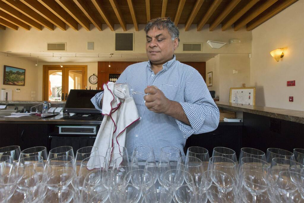 Deepak Gulrajani, owner and winemaker of the Nicholson Ranch, in the tasting room preparing for the busy holiday weekend. (Photo by Robbi Pengelly/Index-Tribune)