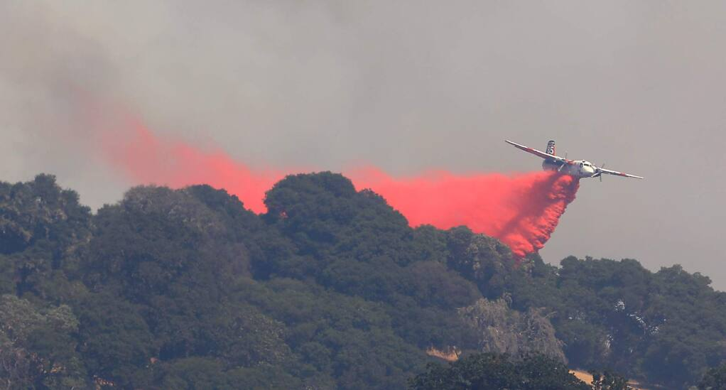 A Cal Fire tanker drops on the left flank, Friday, July 27, 2018 on the River fire in Hopland (Kent Porter / The Press Democrat) 2018