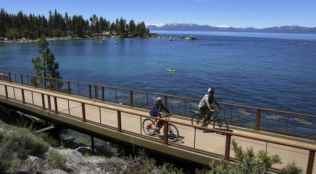FILE - This June 25, 2019, file photo, shows cyclists riding along Lake Tahoe near Glenbrook, Nev. (Jason Bean/The Reno Gazette-Journal via AP, File)