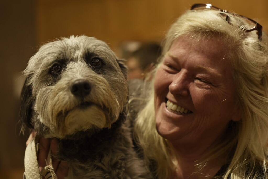 Colleen Combs with Dharma the dog at the 21st annual Paws for Love gala at the Finley Community Center in Santa Rosa  on Saturday, Feb. 8, 2020. (Erik Castro / For The Press Democrat)