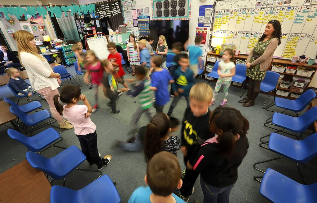 First grade students at Evergreen School in Rohnert Park play a game called 'I Love My Neighbor' during circle time in teacher Mandy Hilliard's class. (John Burgess/The Press Democrat)
