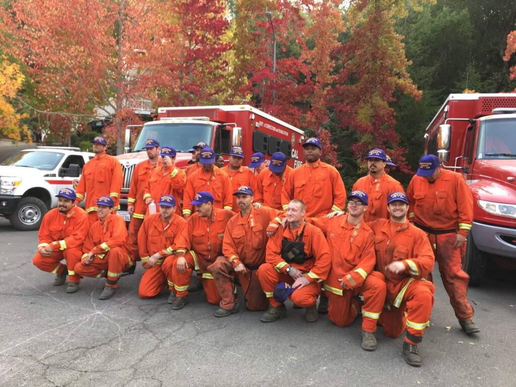 Santa Rosa residents whose homes were saved thank the inmate-firefighters with Washington Ridge Conservation Camp in Nevada County. (Chris Smith / Press Democrat)