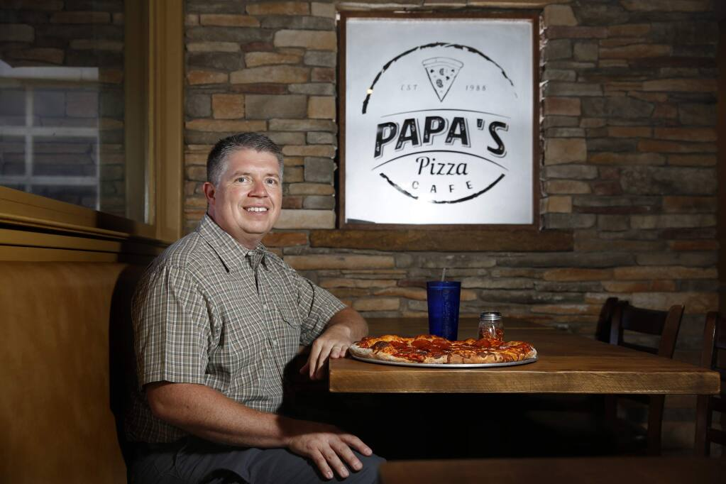 Mike Nixon, the owner of Papa's Pizza Cafe and an insurance agent, in Cloverdale on Tuesday, July 31, 2018. (Beth Schlanker/ The Press Democrat)
