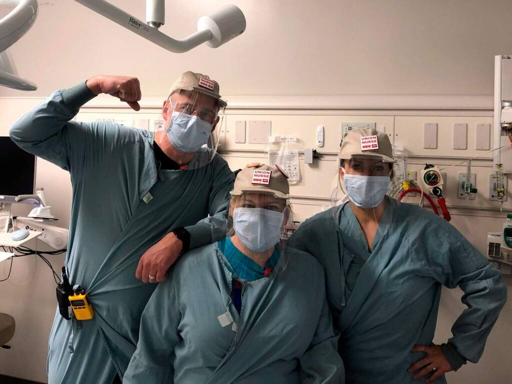 Hospital workers wear baseball cap and plastic shields made by a team led by former Autodesk CEO Carl Bass and partners such as American Canyon-based Kreysler & Associates in late March 2020. (Twitter / Carl Bass photo)