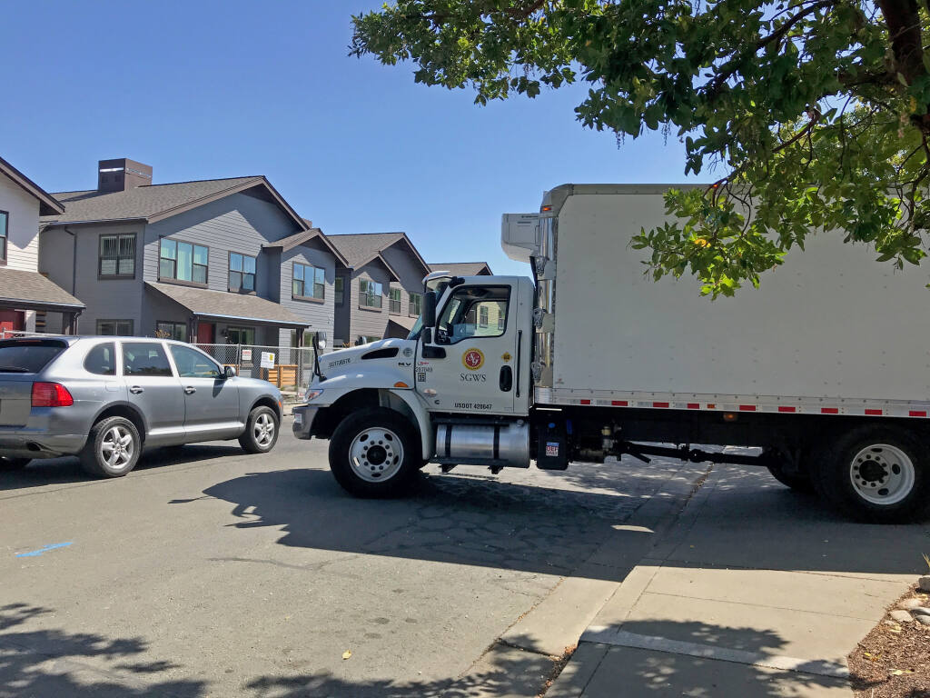 A truck making deliveries to the Lodge at Sonoma is parked on the sidewalk and extending into Clay Street, in this recent photo. Neighbors have long complained that the Lodge does not have a proper loading dock for such deliveries. (Lynn Fiske Watts)
