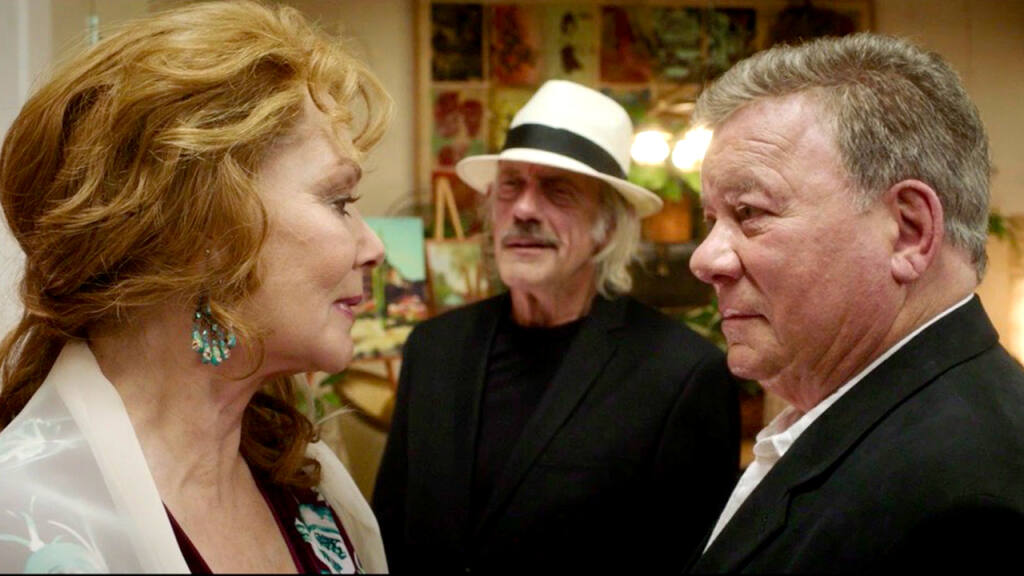 """Jean Smart and William Shatner exchange a look while Christoper Lloyd looks on in the new film """"Senior Moment,"""" premiering locally at the SIFF Summerfest on Aug. 6, 2021, at Chateau St. Jean Winery. (Screen Media Films)"""