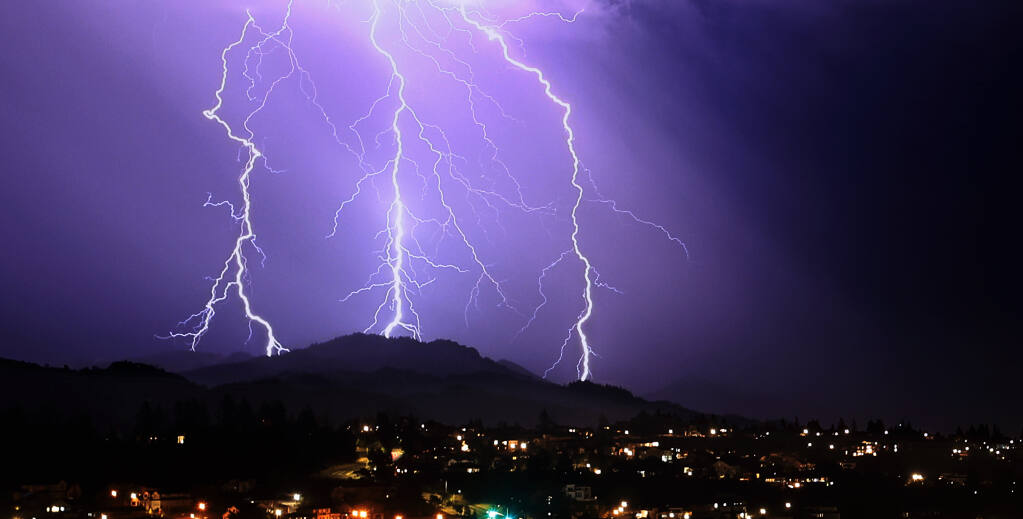 Lightning strikes in the area of Sugarloaf Ridge State Park, Thursday, Sept. 9, 2021.  Santa Rosa's Fountaingrove is in the foreground. (Kent Porter / The Press Democrat) 2021