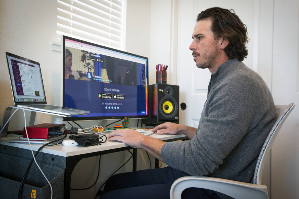 Ben Flajnik, who has worked on CrimeDoor, an app that allows users to enter true crime scenes, in his home office on March 3, 2021. (Robbi Pengelly/Index-Tribune)