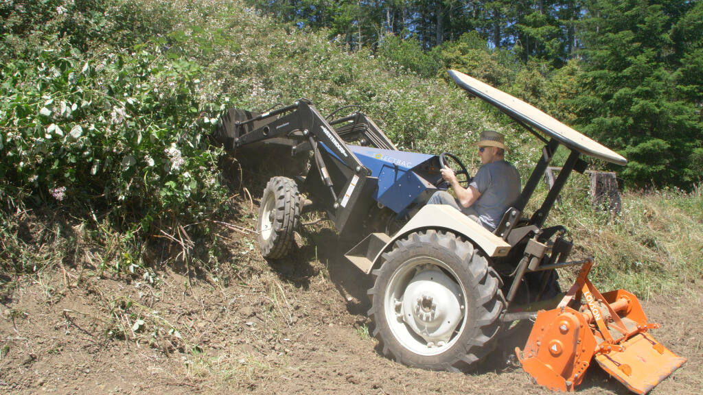 Solectrac founder Steve Heckeroth takes the eUtility tractor out he built for a spin.(Jason Fluhrer photo)