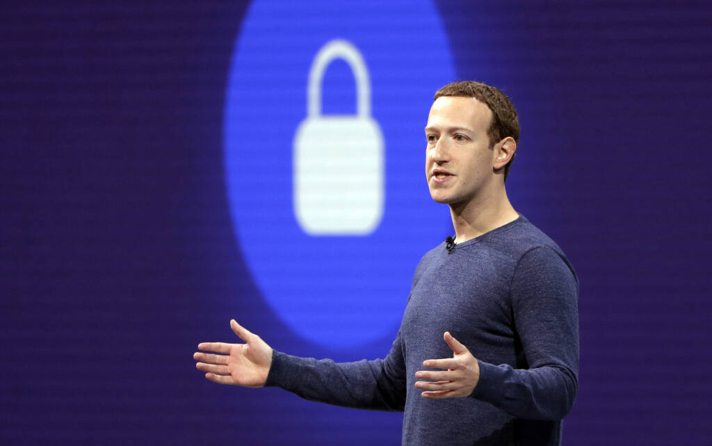 FILE- In this May 1, 2018, file photo, Facebook CEO Mark Zuckerberg delivers the keynote speech at F8, Facebook's developer conference in San Jose, Calif.  (AP Photo/Marcio Jose Sanchez, File)