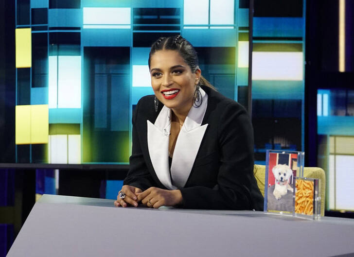 """This image released by NBC shows Lilly Singh, host of """"A Little Late with Lilly Singh."""" The segment """"Lilly Responds to Comments About Her Sexuality,"""" from Singh's late-night talk show won the GLAAD award for for Outstanding Variety or Talk Show Episode. (Scott Angelheart/NBC via AP)"""