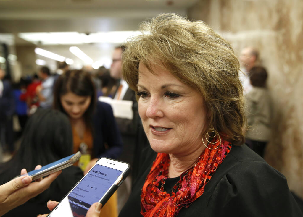 FILE - In this May 9, 2019, file photo, State Sen. Republican Leader Shannon Grove, of Bakersfield, talks to reporters in Sacramento, Calif. A labor consulting company led by Grove received a loan worth $150,000 to $350,000 from the Paycheck Protection Program, a national rescue package aimed to help small businesses during the pandemic, according to records released on Monday, July 6, 2020. Grove listed herself as president and CEO of Continental Labor Resources Inc. on most recent state public disclosure forms, reporting that she drew an income of over $100,000. The loan saved 365 jobs at the company, according to data. (AP Photo/Rich Pedroncelli, File)