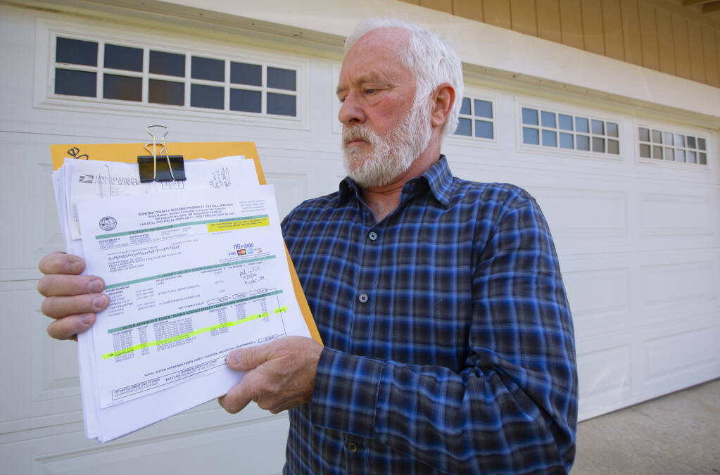 Sonoma resident Scott Pace with his property tax papers, the line item for the Sonoma Valley County Sanitation District highlighted. He's been keeping a keen eye on the charges since 2013, the first time there was a mistake in sanitation district billing. (Photo by Robbi Pengelly/Index-Tribune)