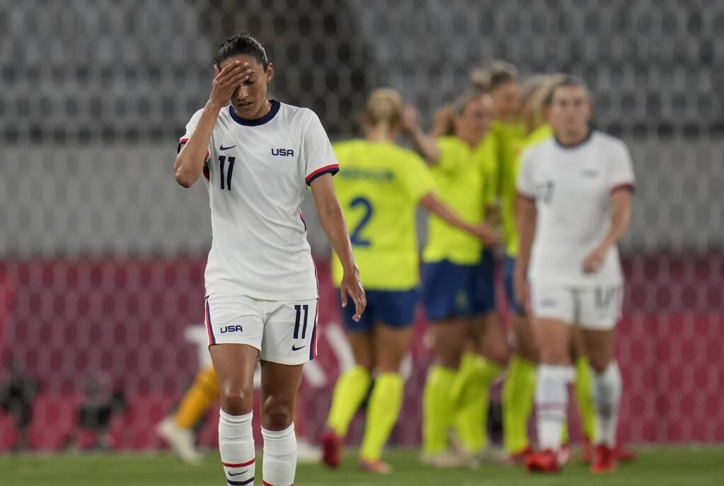 The United States' Christen Press reacts as Sweden's players celebrate their third goal during a game at the Olympics on Wednesday, July 21, 2021, in Tokyo. (Ricardo Mazalan / ASSOCIATED PRESS)