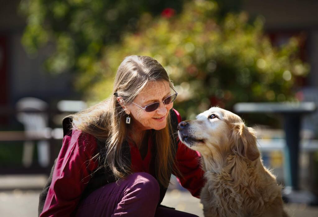 Bonita (Bonnie) Bergin, who founded Bergin University of Canine Studies in Sonoma County, hangs out with Judy the dog on July 10, 2017. (CRISSY PASCUAL/ARGUS-COURIER STAFF)
