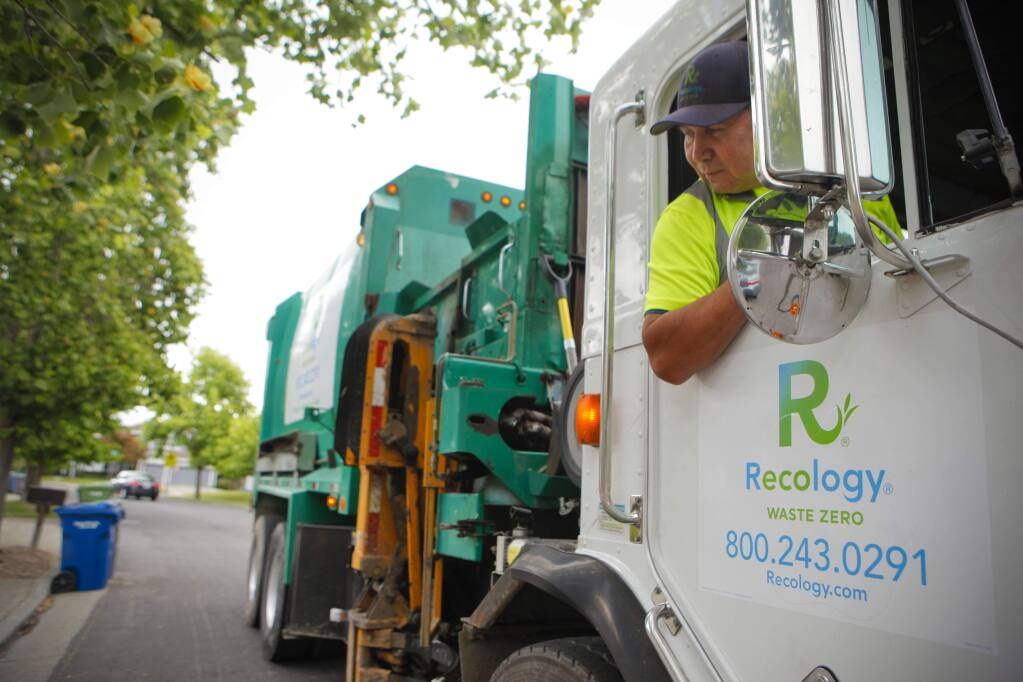 Recology is the new trash collection company in Petaluma. Driver Louie Seidner makes his rounds in an East Petaluma neighborhood. (CRISSY PASCUAL/ARGUS-COURIER STAFF)
