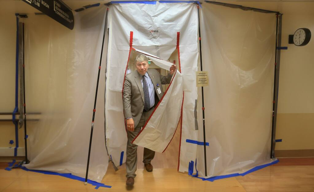 Sonoma West Medical Center CEO Raymond Hino emerges from a construction area at Palm Drive Hospital in Sebastopol as remodeling continues prior to the re-opening of the hospital, Monday March 2, 2015. (Kent Porter / Press Democrat) 2015