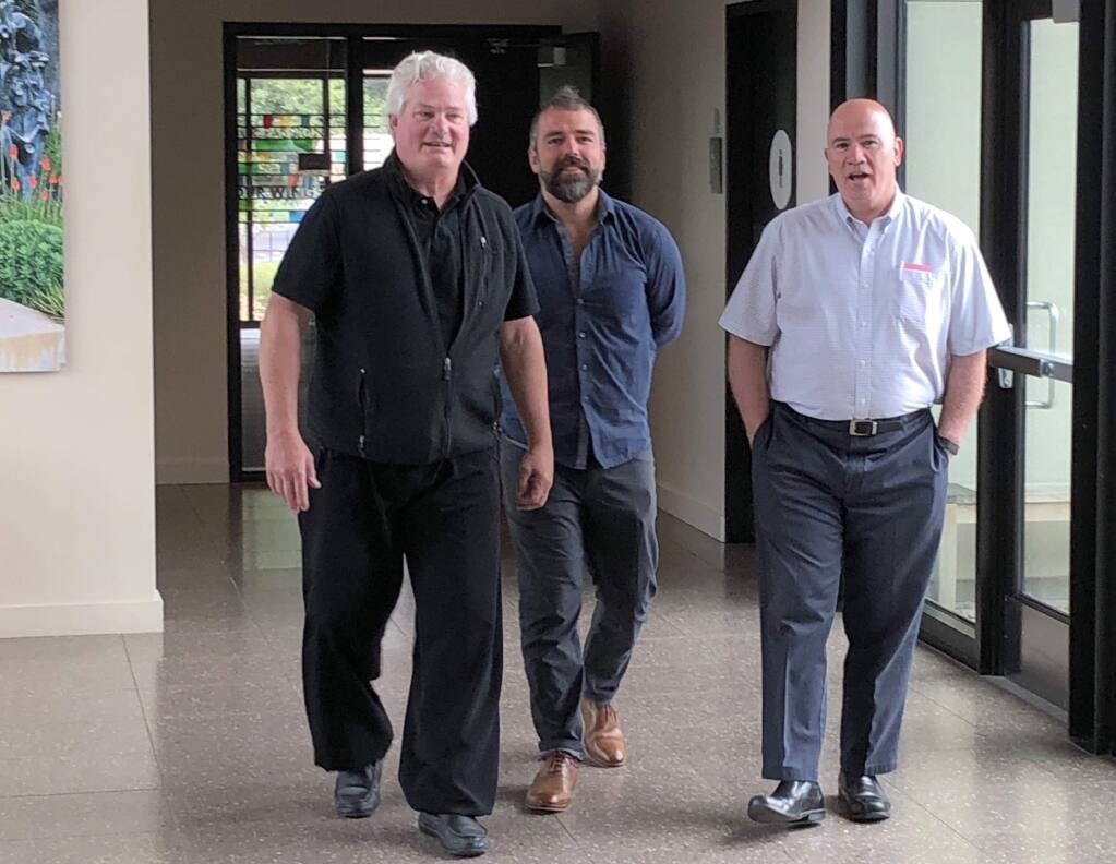 Consultant Dr. Robert Macy, Hanna Institute assistant director Nick Dalton and Hanna Institute interim director Brian Farragher inside Hanna Boys Center.