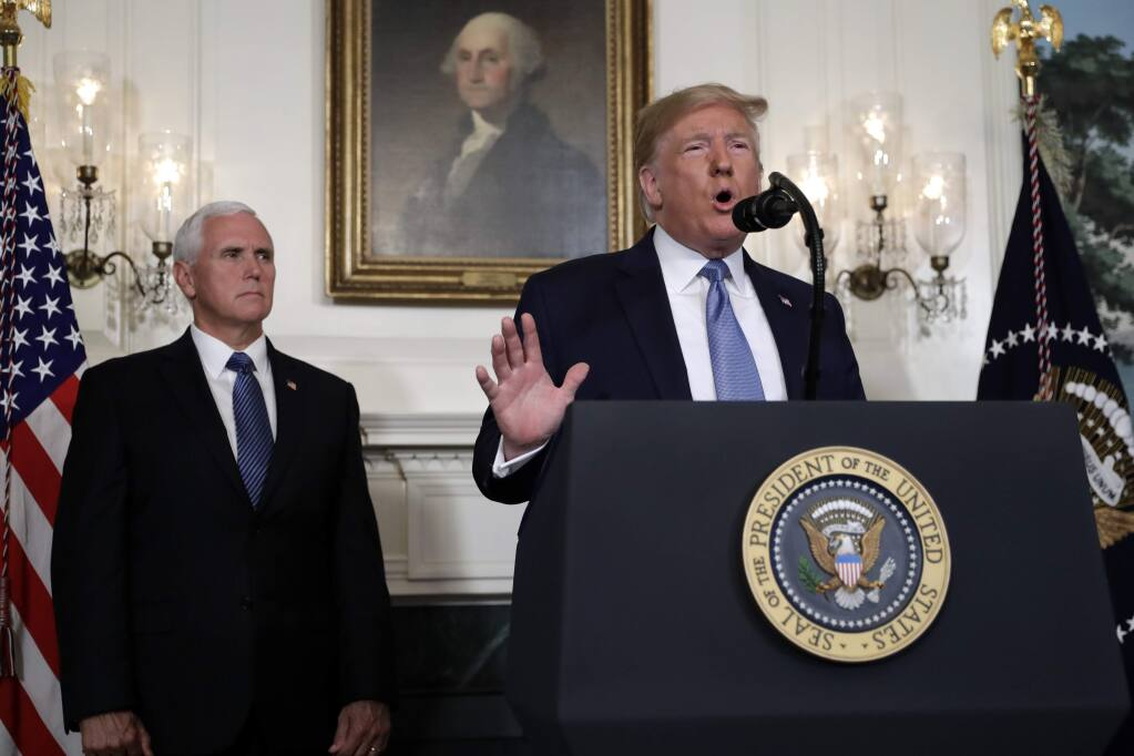 President Donald Trump speaks about the mass shootings in El Paso, Texas and Dayton, Ohio, in the Diplomatic Reception Room of the White House, Monday, Aug. 5, 2019, in Washington. Vice President Mike Pence is left. (AP Photo/Evan Vucci)