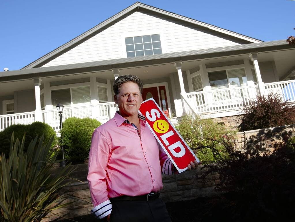 Jeff Schween of Pacific Union stands in front of a Fountaingrove home he sold in September. (Crista Jeremiason / The Press Democrat)