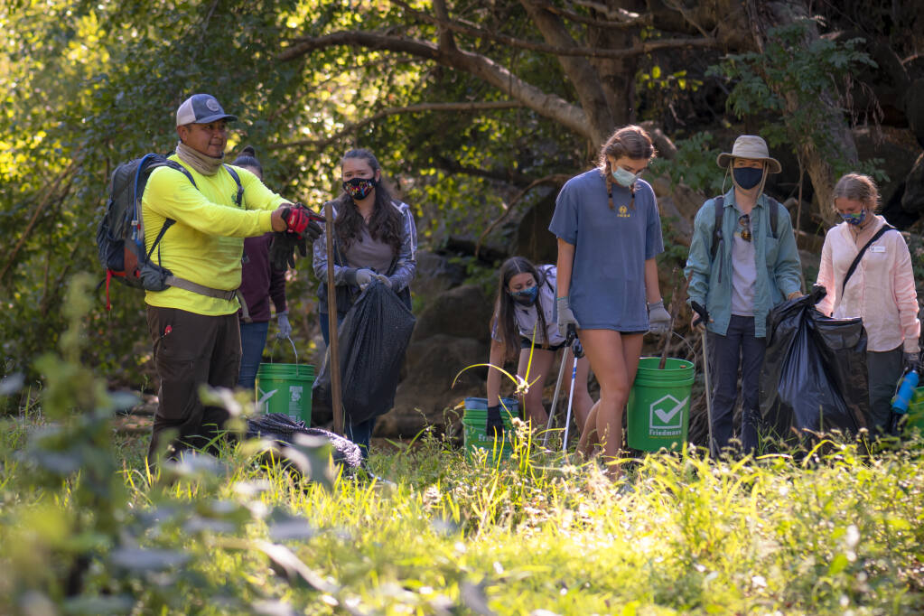 Sonoma Ecology Center's teen EnviroAmbassadors and its restoration department were joined by community volunteers at Nathanson Creek for an event of California Coastal Clean-up month on Sept. 19. Photos by Kristen Russell.