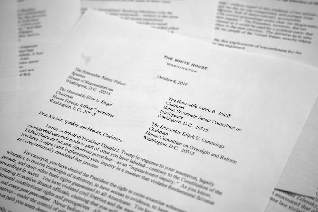 A letter from White House counsel Pat Cipollone is photographed in Washington, on Tuesday, Oct. 8, 2019. The White House declared it will not cooperate with what it termed the 'illegitimate' impeachment probe by House Democrats, sharpening the constitutional clash between President Donald Trump and Congress. Trump attorneys sent a letter to House leaders bluntly stating their refusal to participate in the quickly moving impeachment investigation. (AP Photo/Jon Elswick)