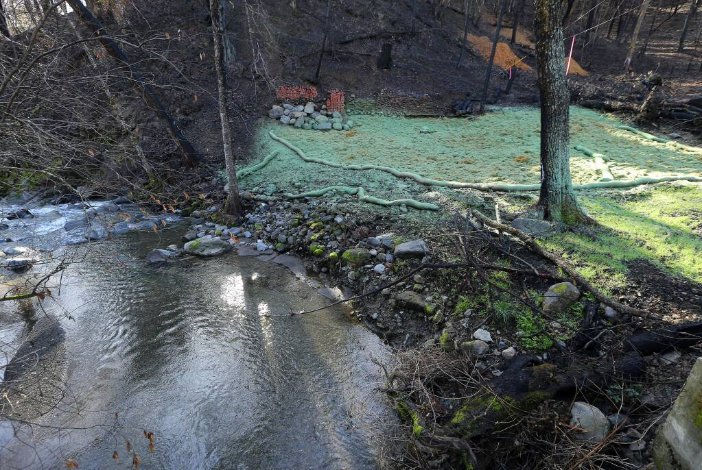 Many Anderson Springs residents may be unable to rebuild because their homes were too close to the creek, as were their septic systems. The lots there are so tiny, there's no way for some to do the legal setbacks required by the state. (JOHN BURGESS / The Press Democrat)