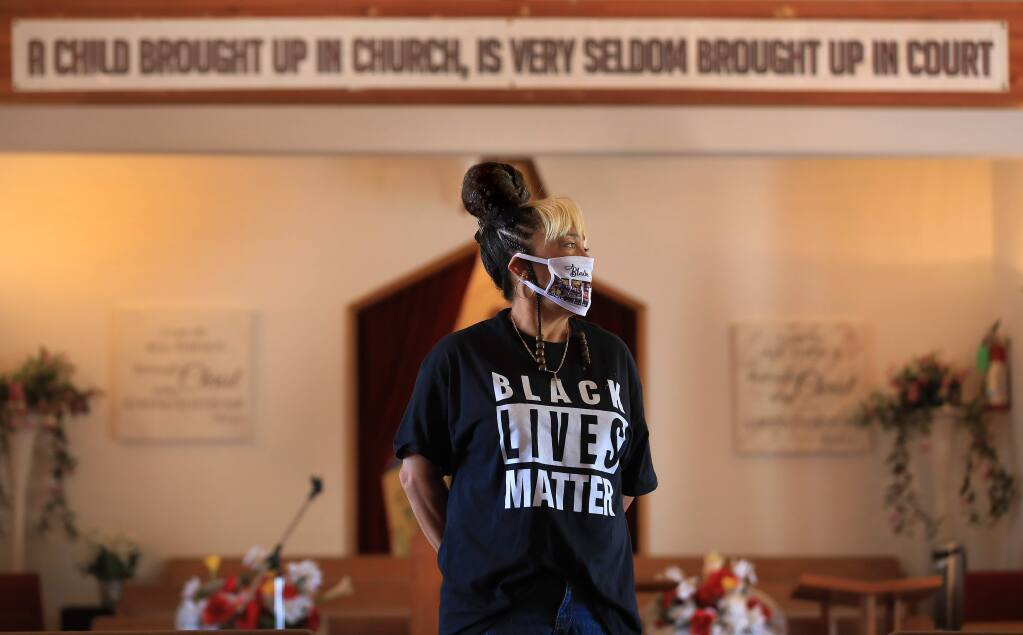 Sydni Locke-Davenport inside the chapel of New Beginnings Ministry Of Love on South Wright Road in Santa Rosa, Wednesday, June 17, 2020. Locke-Davenport's grandmother Marteal Perry who helped to organize the church, started Santa Rosa's Juneteenth celebration in 1954. (Kent Porter / The Press Democrat) 2020